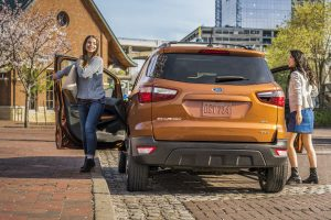 two women getting out of a gold 2018 Ford EcoSport
