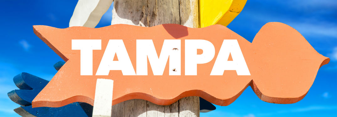 orange sign with Tampa written on it