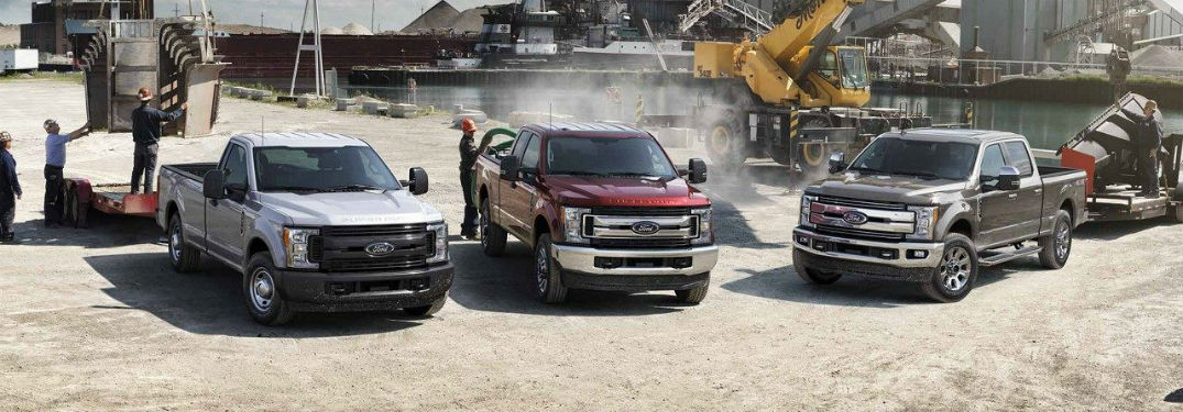 three 2019 Ford Super Duty trucks parked next to each other