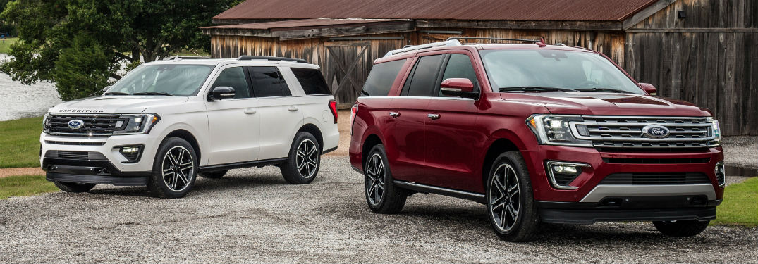 a red 2019 Ford Expedition parked next to a white 2019 Ford Expedition