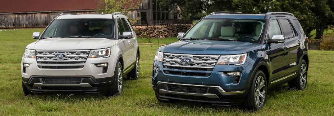 front view of two 2019 Ford Explorer SUVs