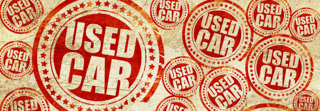 red used car stamp all over a tan background