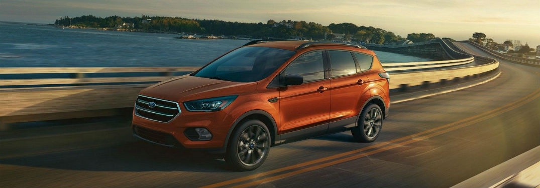 side view of an orange 2019 Ford Escape