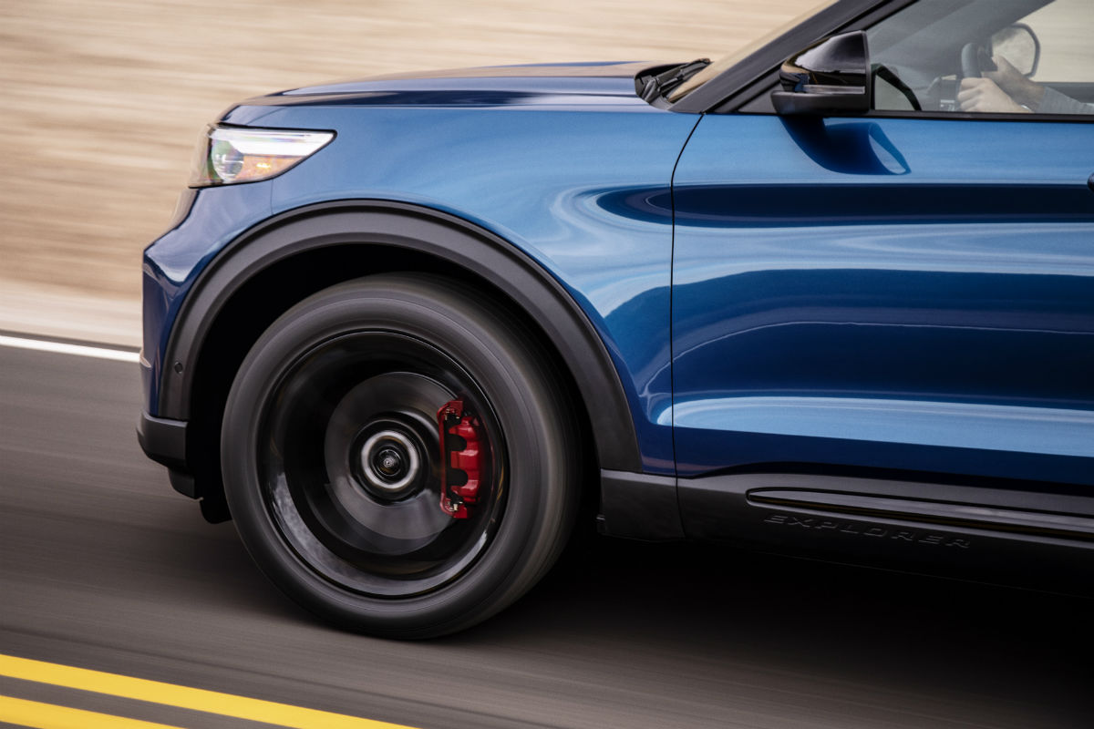 front wheel of a blue 2020 Ford Explorer