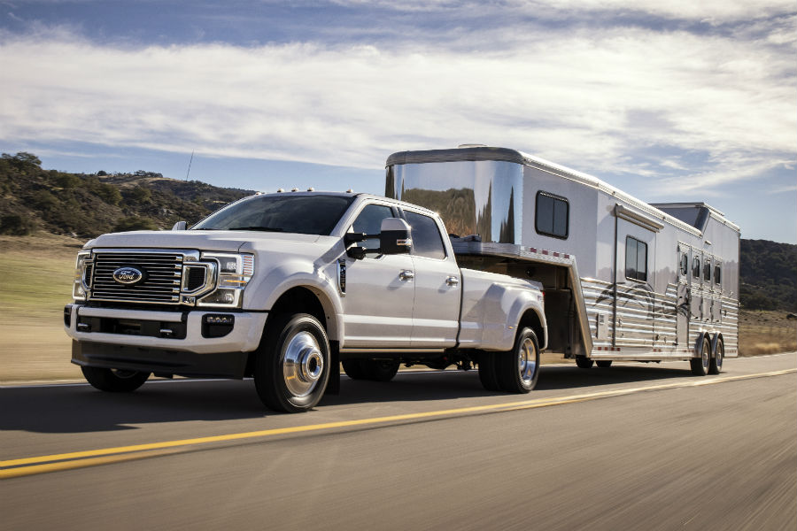 F-white-2020-Ford-F-450-Super-Duty-towing-a-camper