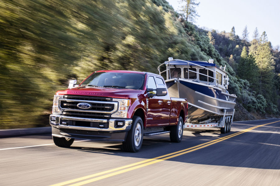 front view of a red 2020 Ford Super Duty towing a boat