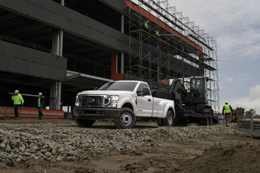 white-2020-Ford-F-350-Super-Duty-towing-construction-equipment