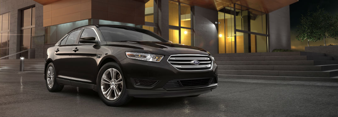 side view of a black 2019 Ford Taurus