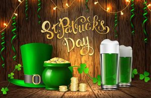 green hat, pot of gold and beer around Happy St. Patrick's Day
