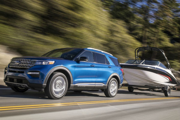 side view of a blue 2020 Ford Explorer Hybrid