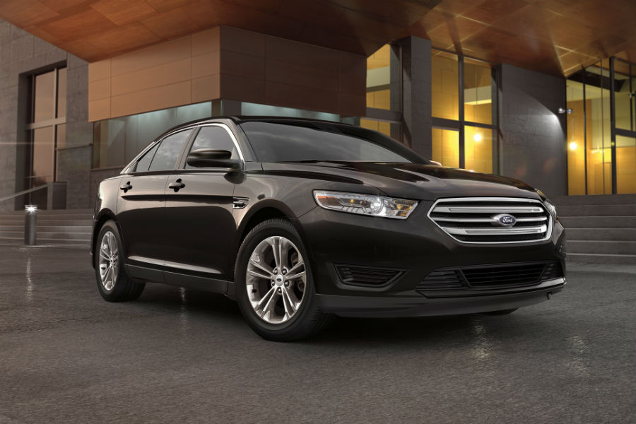 side-view-of-a-black-2018-Ford-Taurus_o