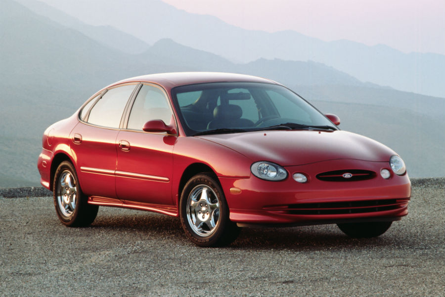side-view-of-a-red-1996-Ford-Taurus_o