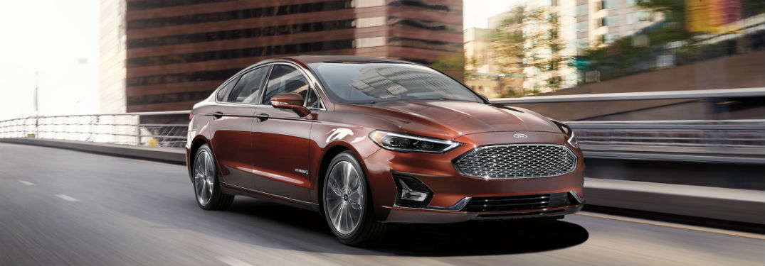 side view of a copper 2019 Ford Fusion Hybrid