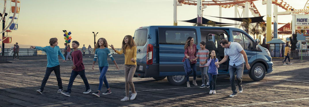 a family getting out of a blue 2020 Ford Transit