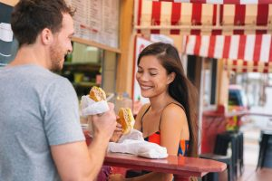 couple eating Cubano sandwiches in Tampa Florida