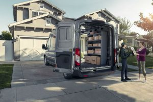 rear view of a silver 2020 Ford Transit with rear cargo door open