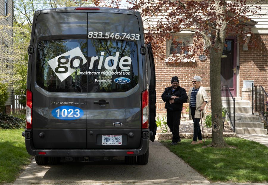 helping an older lady into the Go Ride van