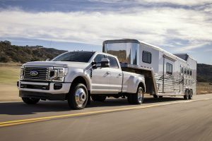 white 2020 Ford F-450 Super Duty towing a camper