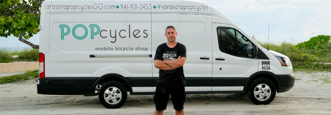 man in front of his white Ford cargo van