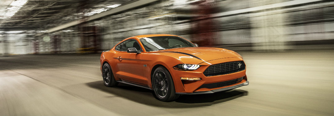 side view of an orange 2020 Ford Mustang