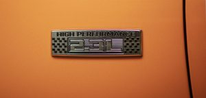 high-performance badge on a 2020 Ford Mustang