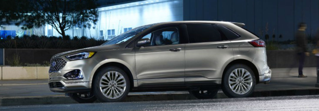 side view of a silver 2020 Ford Edge
