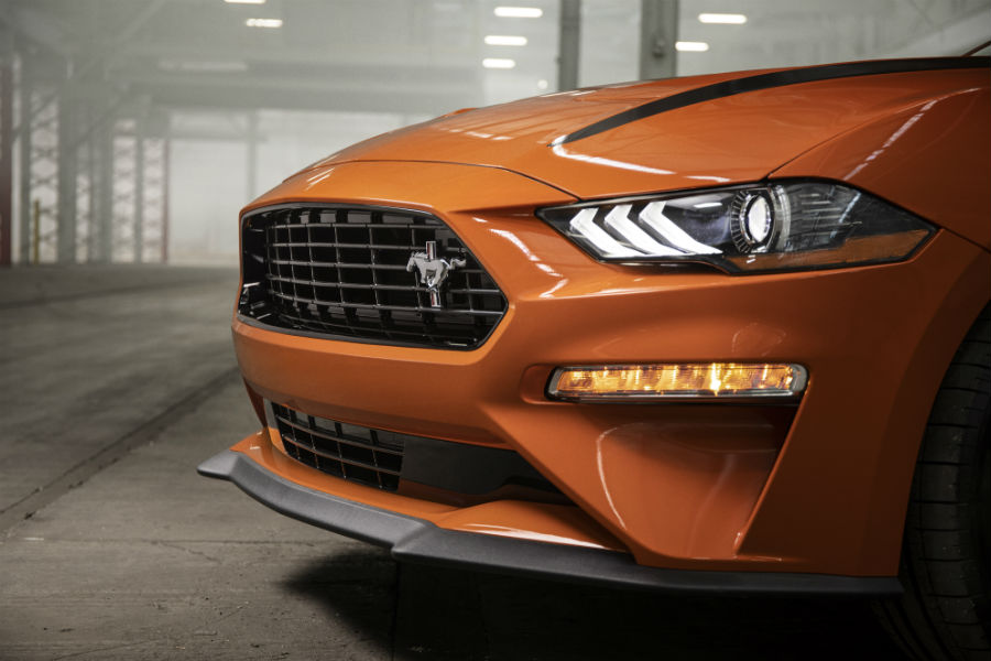 front end of an orange 2020 Ford Mustang