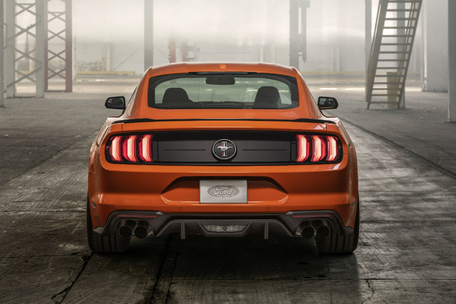 rear end of an orange 2020 Ford Mustang