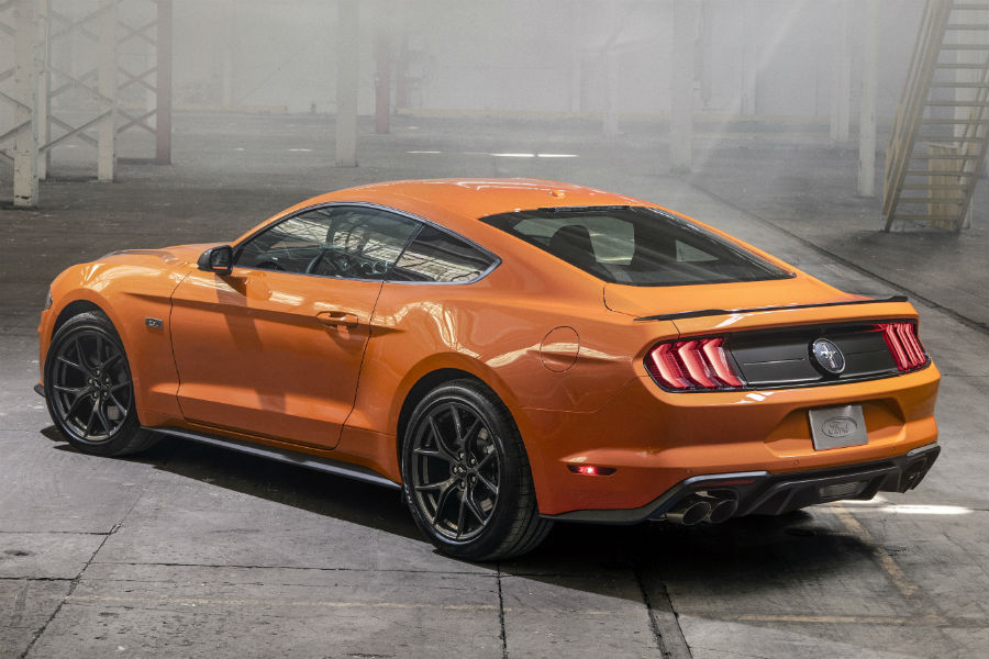 rear view of an orange 2020 Ford Mustang