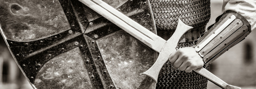 black and white pic of a sword and shield