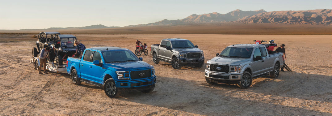 three 2020 Ford F-150 trucks in the desert