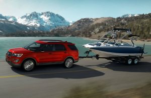 red 2017 Ford Explorer towing boat