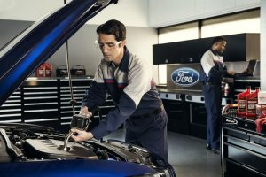Ford service technicians working on a car