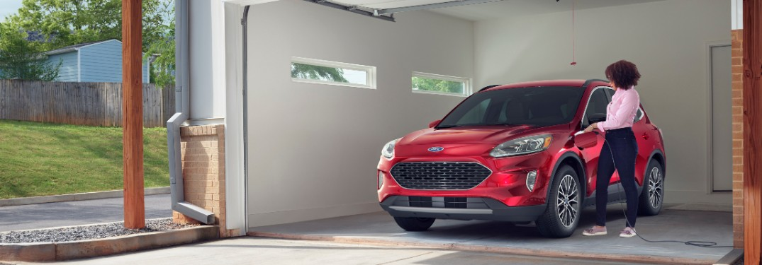 woman charging her 2020 Ford Escape Plug-In Hybrid