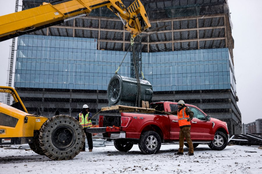 red 2021 Ford F-150 at a construction site