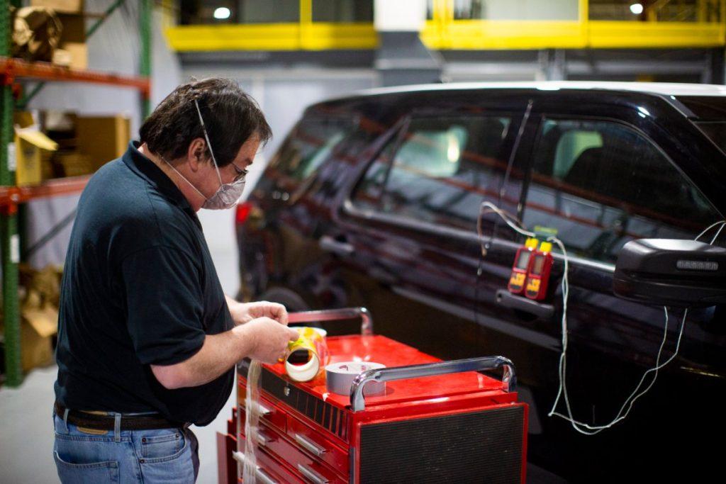 man sanitizing a car