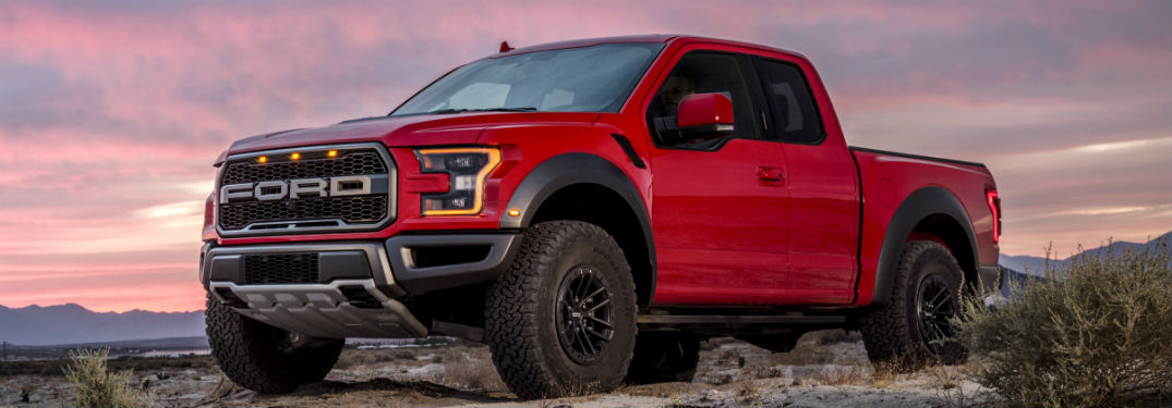 side view of a red Ford F-150 Raptor