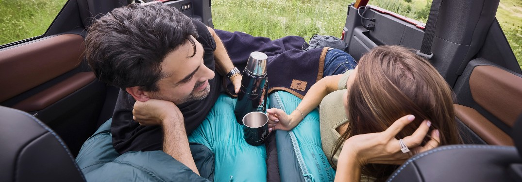 couple laying in the back of a 2021 Ford Bronco