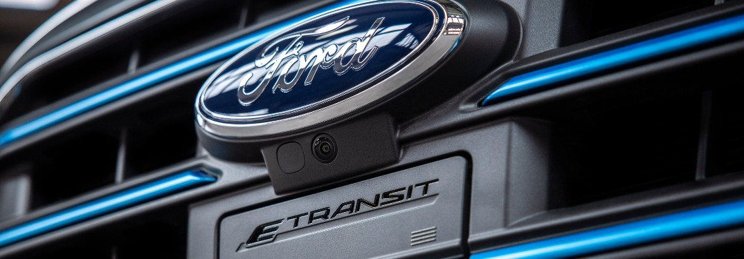 Ford logo and charging port on a 2021 Ford E-Transit