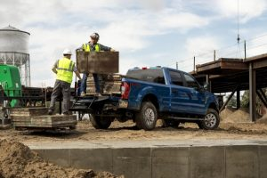 men using rear step of 2021 Ford Super Duty