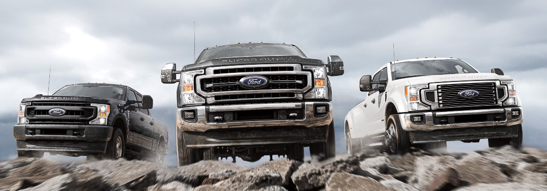 three 2021 Ford Super Duty trucks