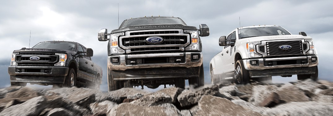 front view of three 2021 Ford Super Duty trucks