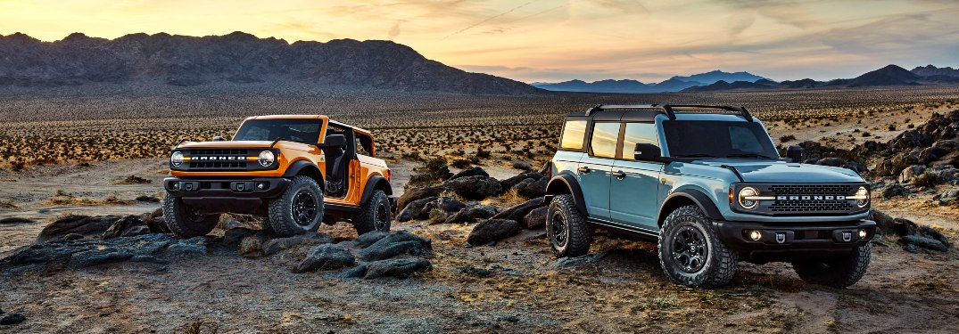two 2021 Ford Bronco SUVs in the desert