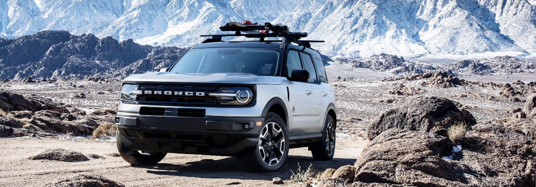 front view of a white 2021 Ford Bronco Sport with a roof rack
