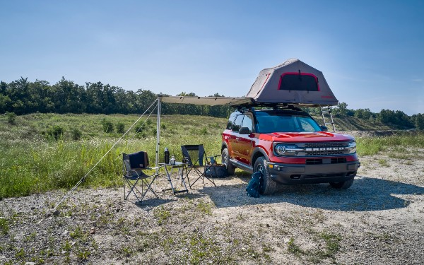 front view of a red 2021 Ford Bronco Sport with a tent
