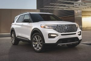 front view of a white 2021 Ford Explorer Platinum Hybrid
