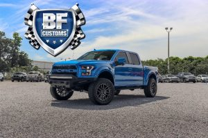 side view of a blue Ford Super Duty with BF Customs logo