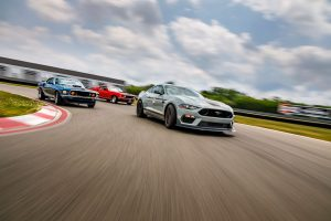 three Ford Mustang race cars
