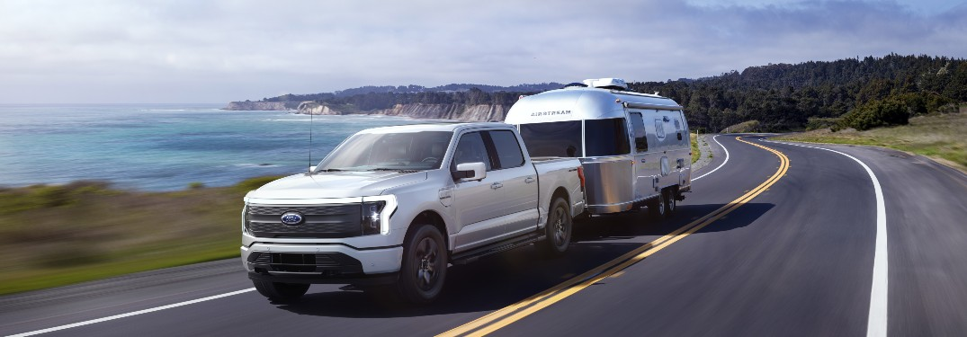 2022 Ford F-150 Lightning towing a camper