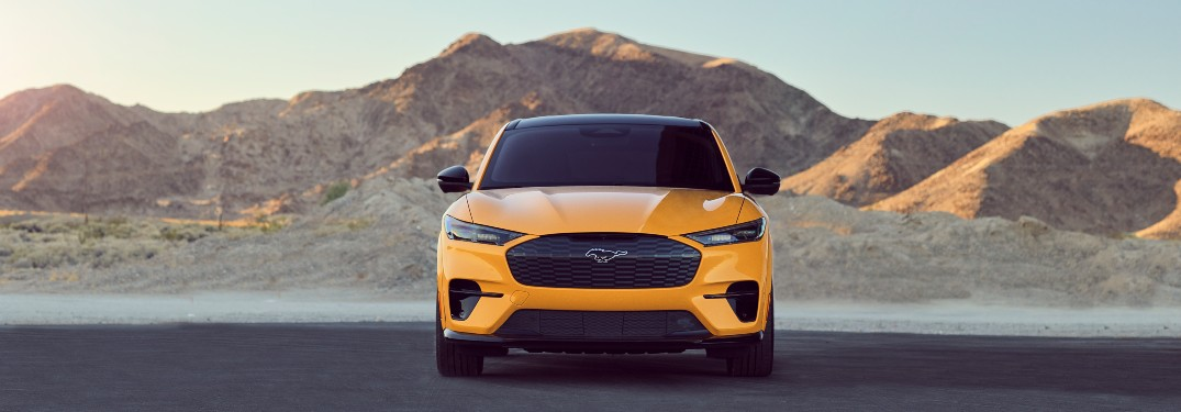 front view of a yellow 2021 Ford Mustang Mach-E